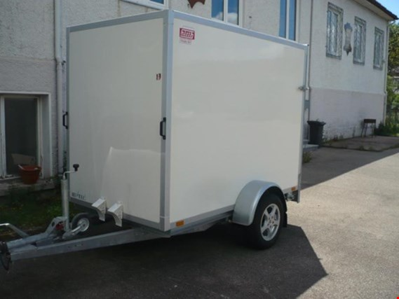 used car and single-axle trailer
