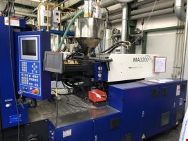 Injection molding machines and thermoforming machines