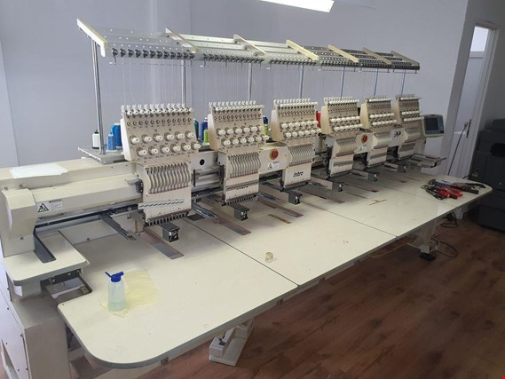 Online sale paper and printing machines as well as a BMW 560L