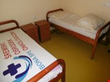 wooden hospital bed